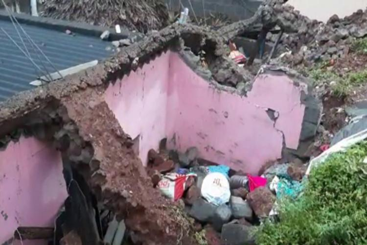 A house in Gajuwaka collapsed because of rains the house has pink walls and tin roof