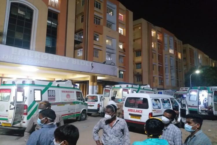 Several ambulances with patients wait at Gandhi Hospital for beds