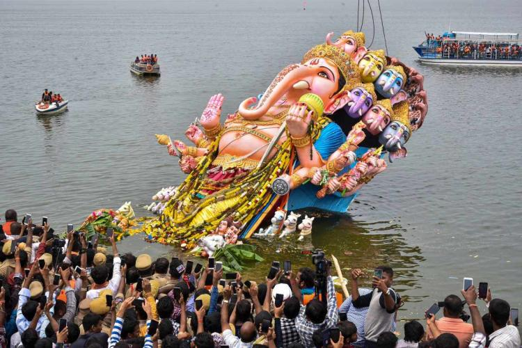 A Ganesh idol being immersed in Hussain Sagar lake