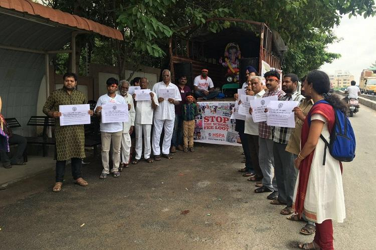 Hyderabad parents stage unique protest over school fees immerse govt orders with Ganesha idol