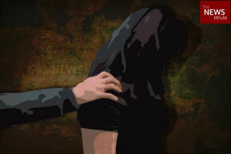A representative image of sexual assault on a woman