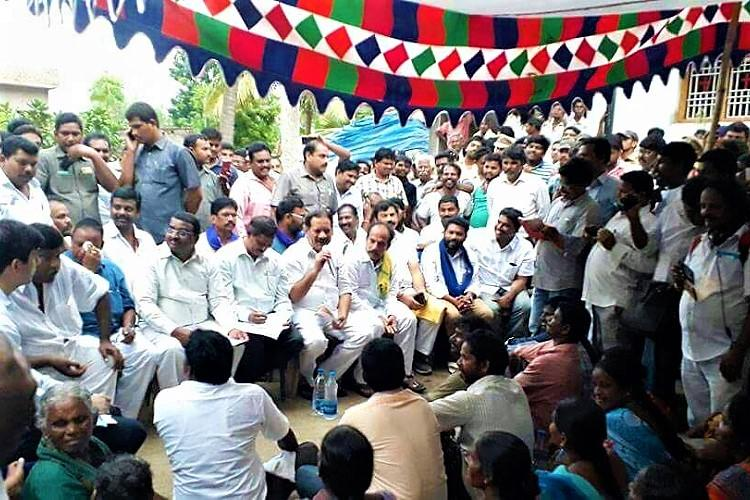 Andhra Ministers meet groups warring over Ambedkar statue in Garagaparru broker peace