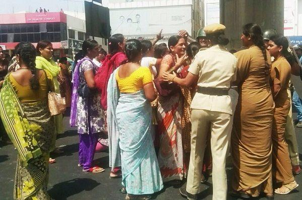 Garment workers block major Bengaluru roads for second day police use tear gas on unruly protesters