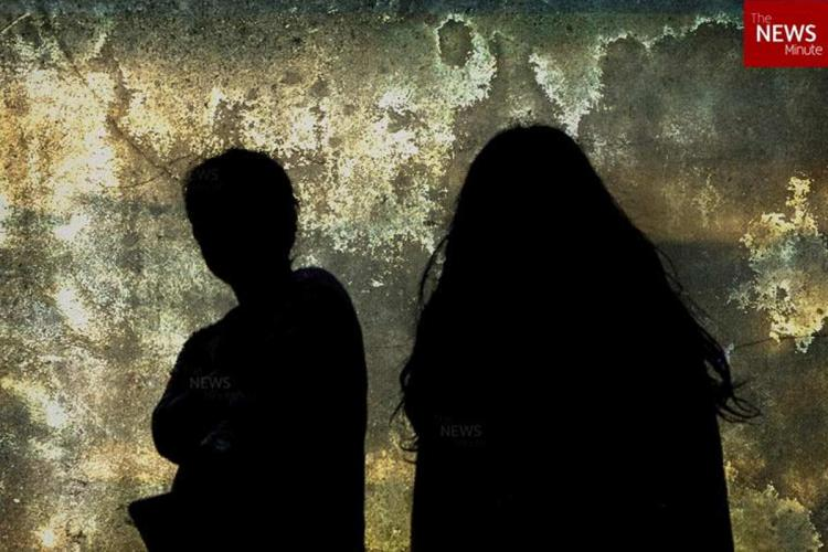Silhouette of two girls standing together