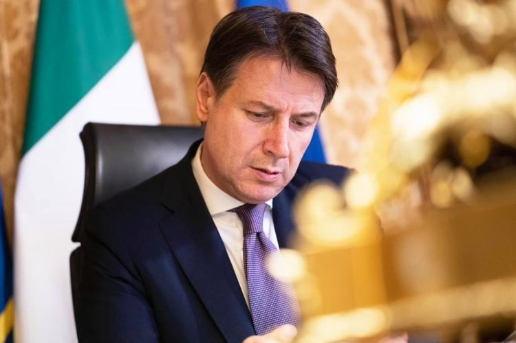 Giuseppe Conte sitting in his office