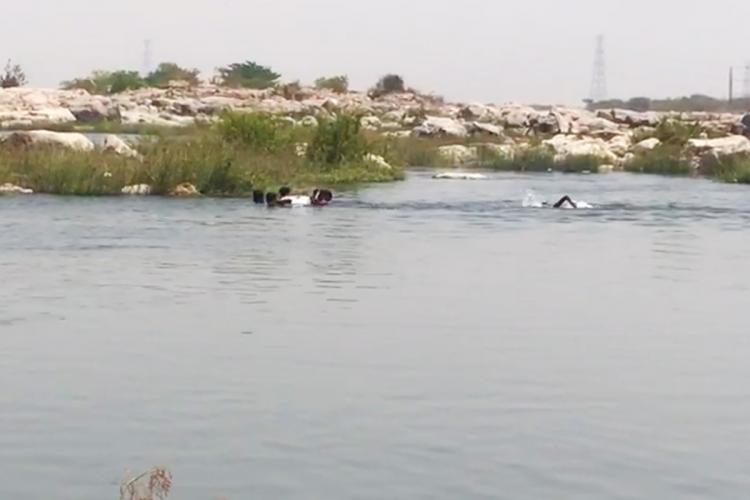 An image of fishermen searching for the drowned persons