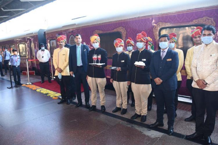 Staff of the Golden Chariot train standing in front of it