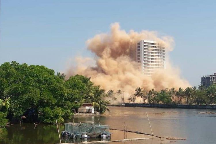 A water front building crashing down