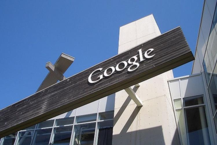 White building with black sign saying Google