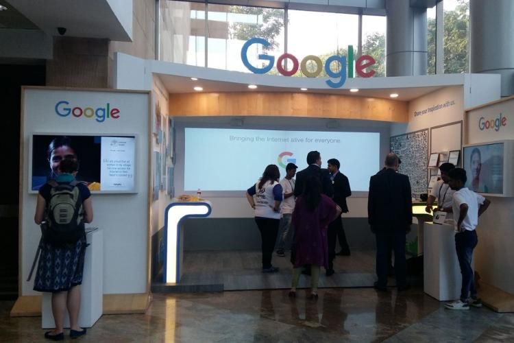 Google office lounge with employees standing around