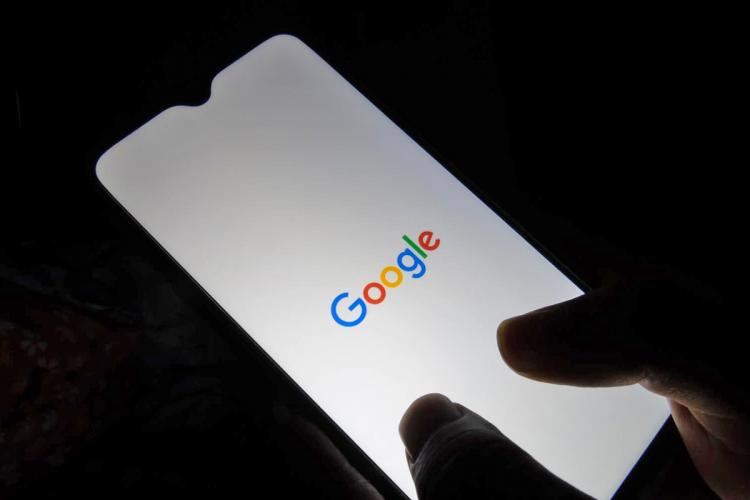 A person doing a Google search on a mobile