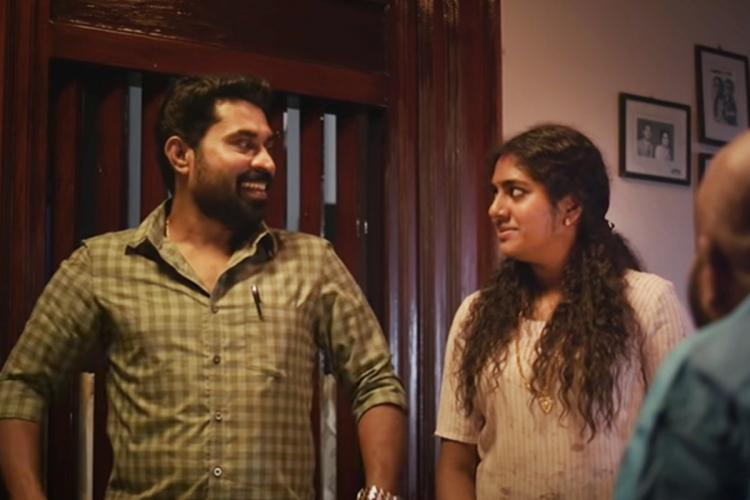 Suraj Venjaramoodu and Nimisha Sajayan looking at each other in The Great Indian Kitchen