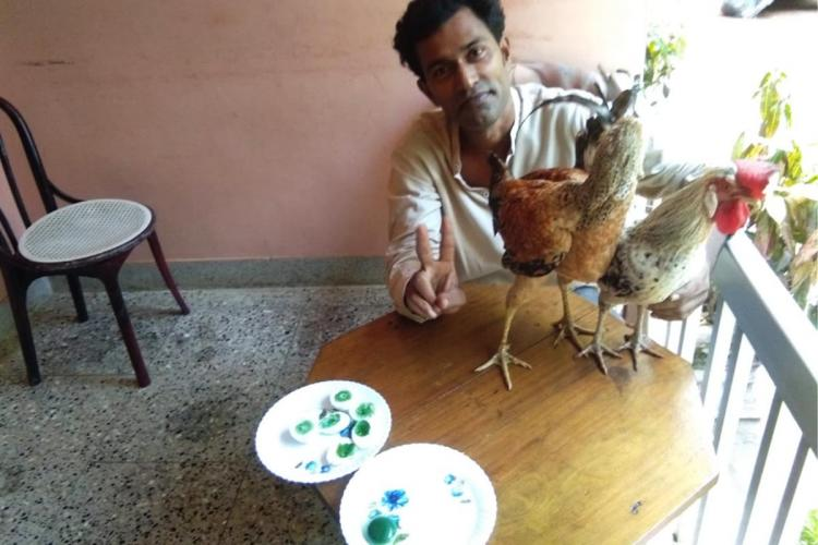 Shihabudheen from Malappuram with his hens which lay eggs with green coloured yolk