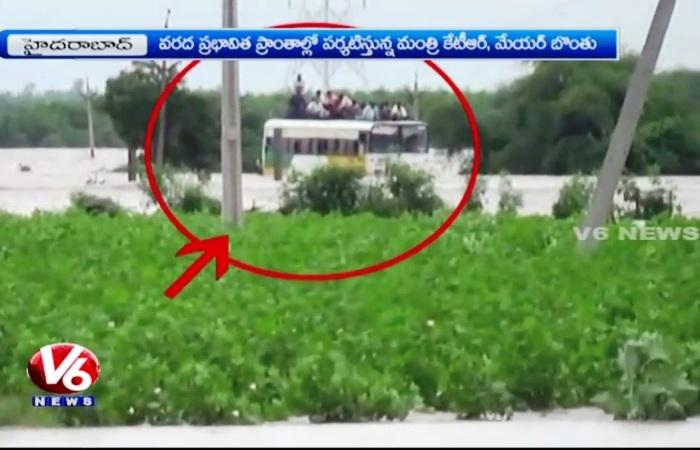 Video Passengers stranded atop bus in Guntur after heavy rainfall