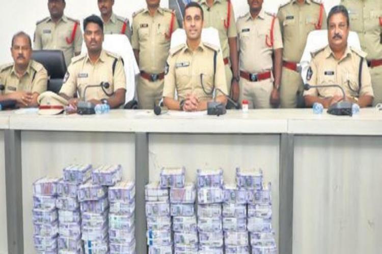 Two men robbed Rs 77 lakhs from SBI bank at Guntur