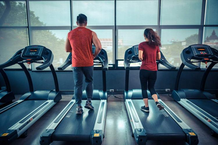 Two people working out in a gym