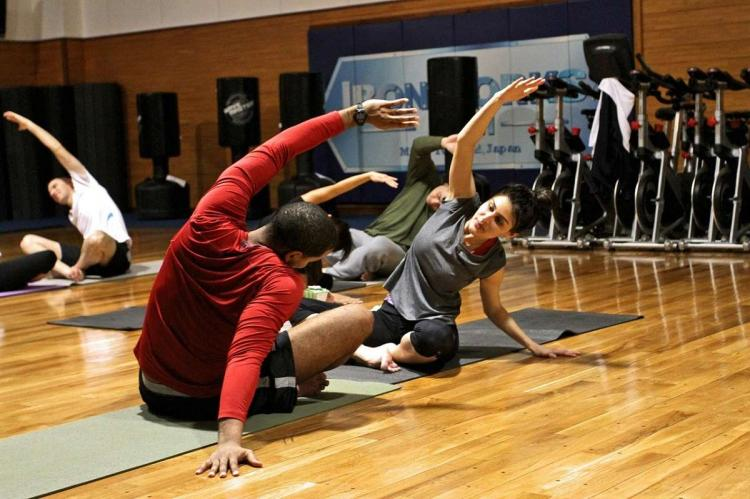 a representative image of gyms showing a man and woman working out on the floor