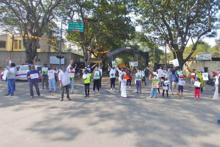 Residents Protest at HAL Junction they formed a human chain to stop felling of trees