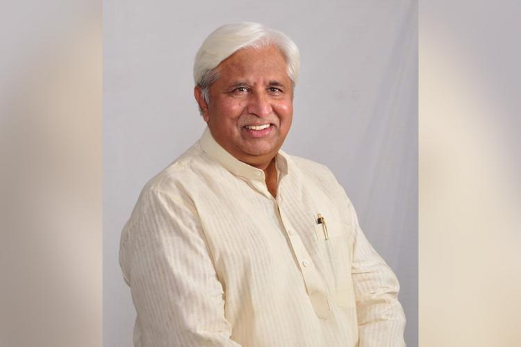 Congress MLA HK Patil smiles at the camera in this file photo he has all white hair and all white clothes