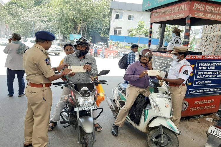 Follow traffic rules get free movie ticket Hyd cops initiative to curb violations