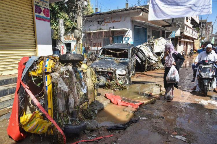 Vehicles damaged in Hafiz baba nagar of Hyderabad due to breach of bund and heavy rains and flooding