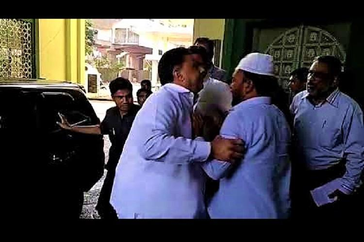 Watch Wakf board chairman in scuffle in Hyd TRS activist held after video goes viral