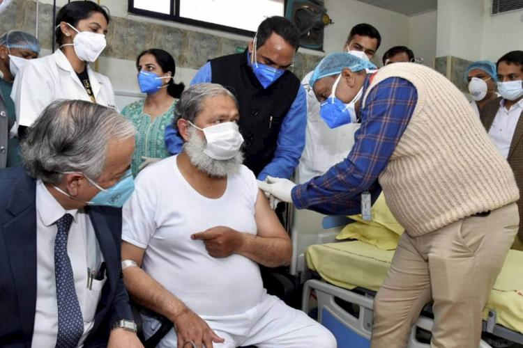 Haryana Health Minister receiving the vaccine candidate