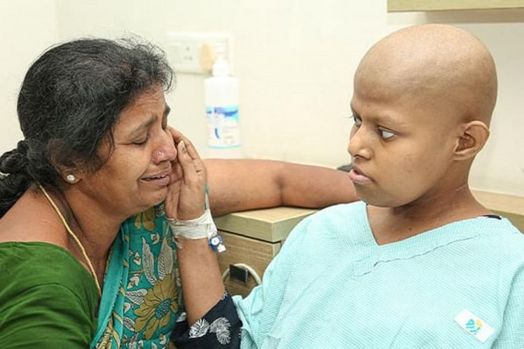 Harshini in the hospital with her mother