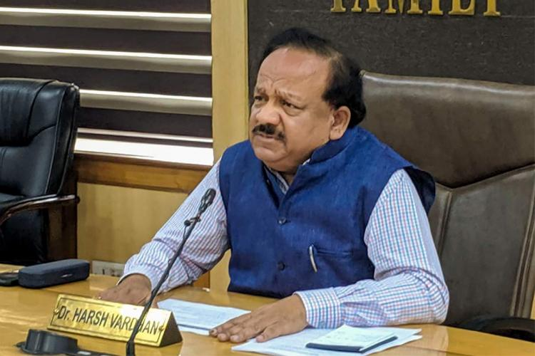 Union Health Minister Harsh Vardhan wearing a blue kurta and a navy blue vest seen at a press conference in Delhi