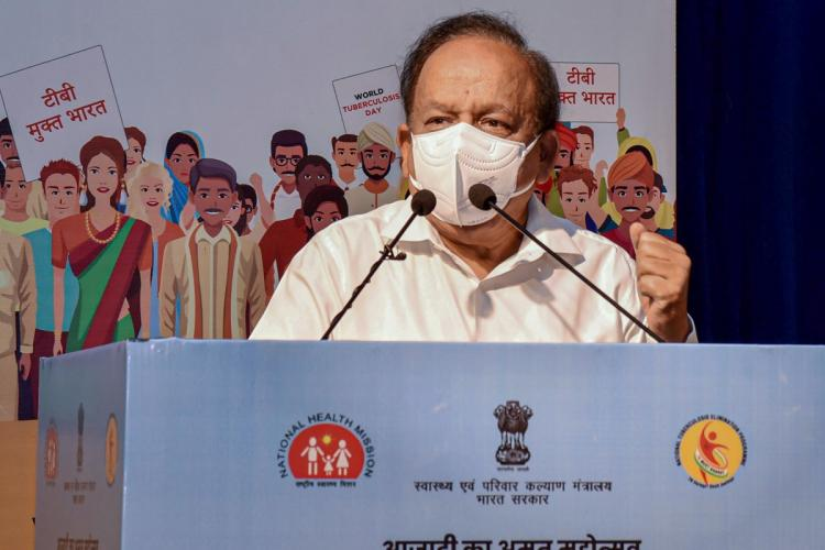 Harshvardhan wearing mask and addressing media