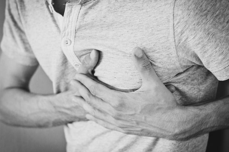 A man seen clutching his chest
