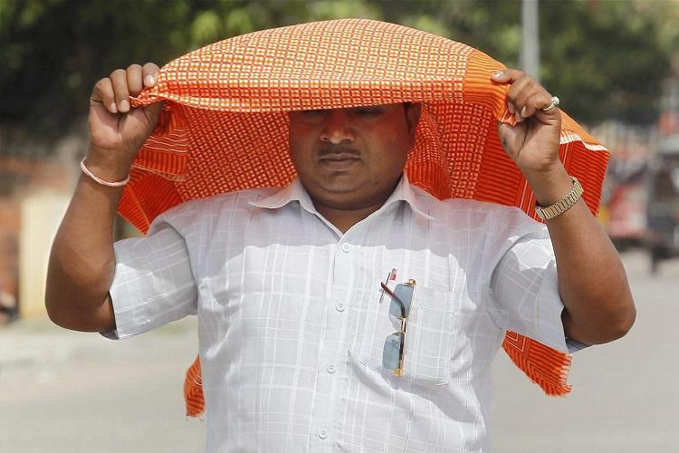 Parts of Telangana reel under heat at 45 degree Celsius IMD predicts thundershowers for Hyd