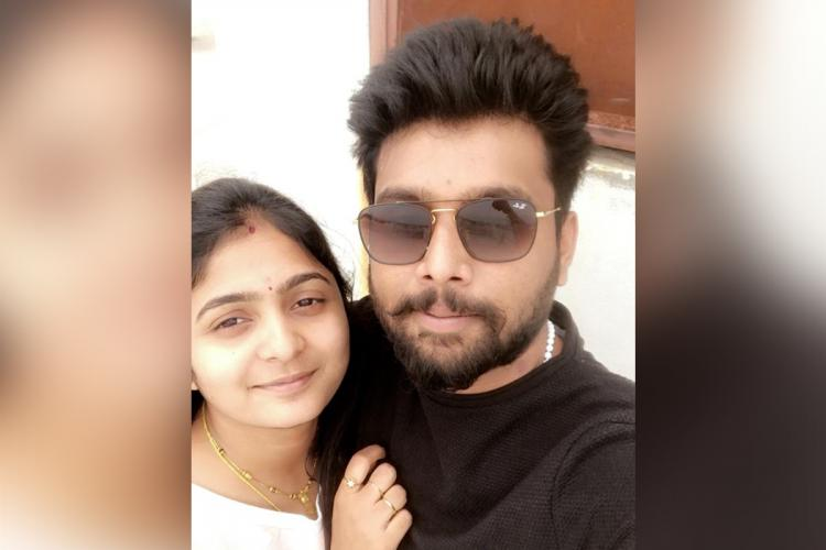 Hemanth in a black shirt and shades hugging Avanthi dressed in white