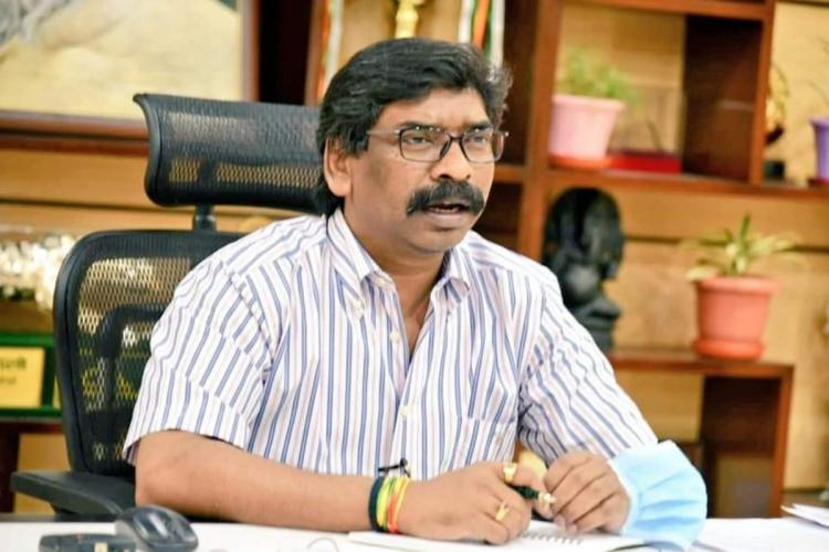 A file image of Jharkhand CM Hemant Soren speaking with officials