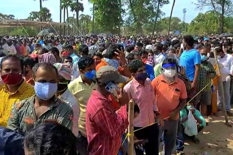 People gathered during the distribution of Anandaiahs medicine
