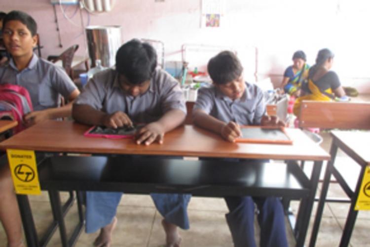 Children seated at their desks in Hidden Sprouts school in Vizag