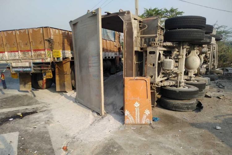 Truck overturned after collision at Himayat Sagar toll gate.
