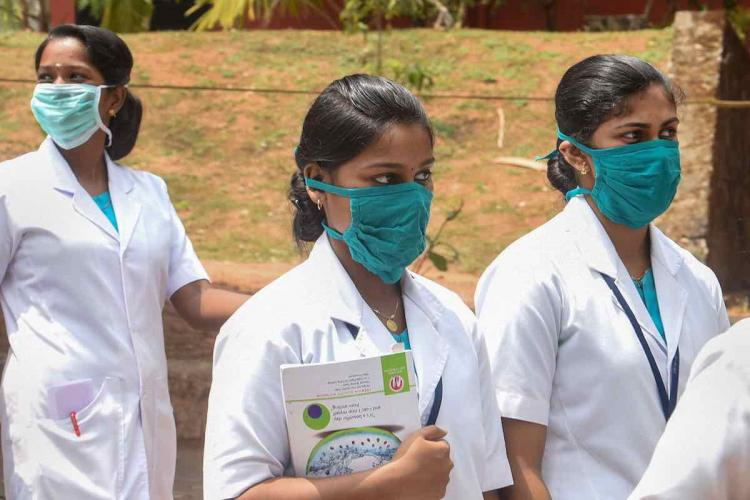 Medical professionals wearing masks cuz of COVID19