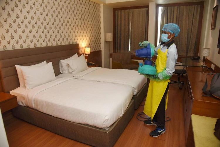 A worker sanitises a room in a hotel ahead of its reopening during the ongoing COVID-19 lockdown