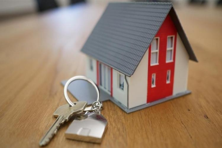 Model of a house along with house key