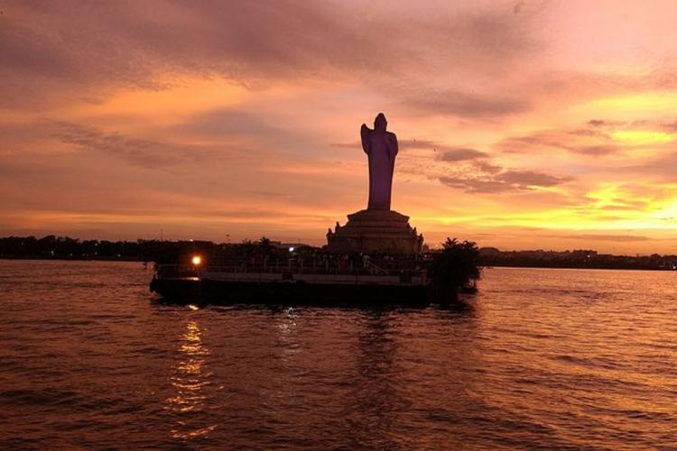 Buddha statue during sunset on Hussain Sagar lake