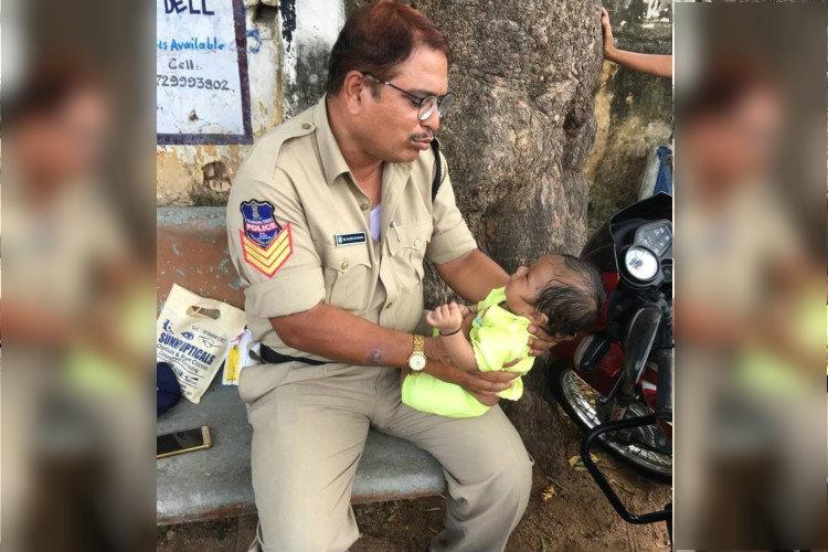 Telangana cop consoles baby as mother writes exam picture goes viral