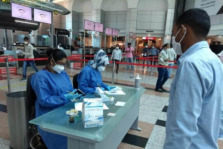 A migrants evacuated from Kuwait being screened at Hyderabad airport