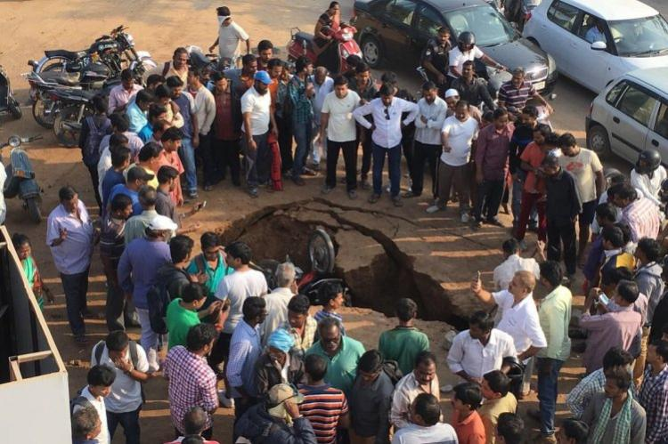 Hyderabad enraged as road caves in and swallows two bikes at Safilguda