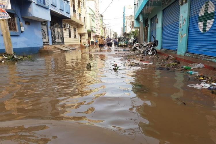 a flooded street at hafiz baba nagar at old city of Hyderabad
