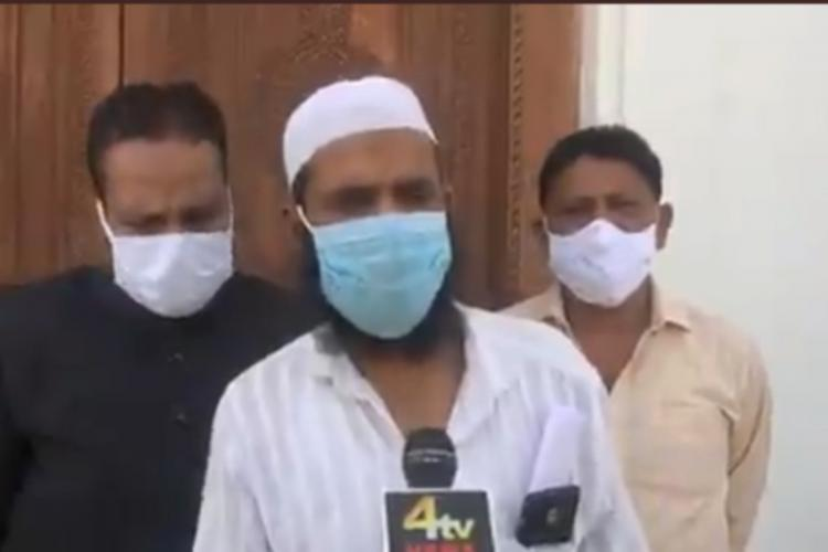 Mohammed Subhan in the centre was assaulted and narrated the same to media