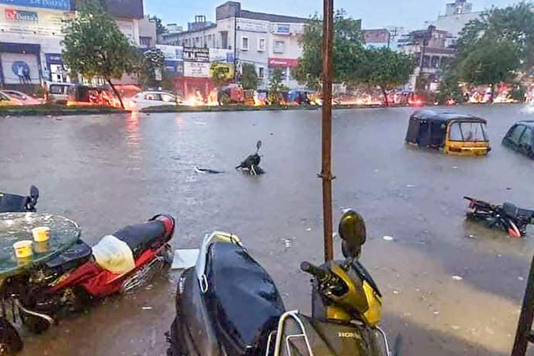 Vehicles are seen inundated with the incessant rains that occured in Hyderabad