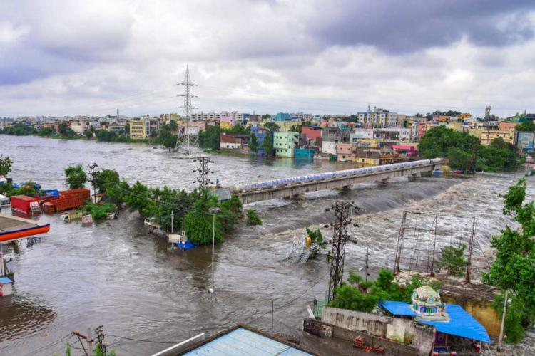 An area in Hyderabad is submerged after the heavy rainfall Houses petrol station several vehicles can be seen submerged in this aerial shot