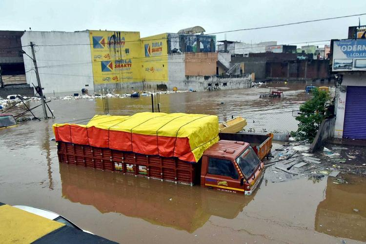 A truck submerged under water in Hyderabad on the October 13 night non stop rains