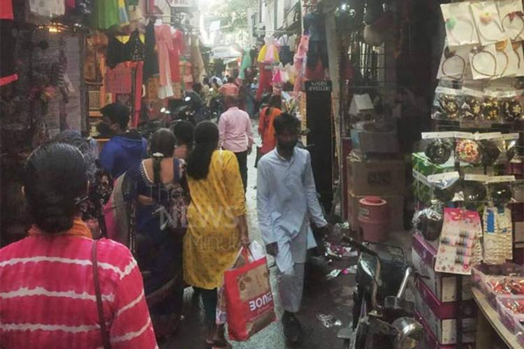A crowded narrow street in a market in Hyderabad